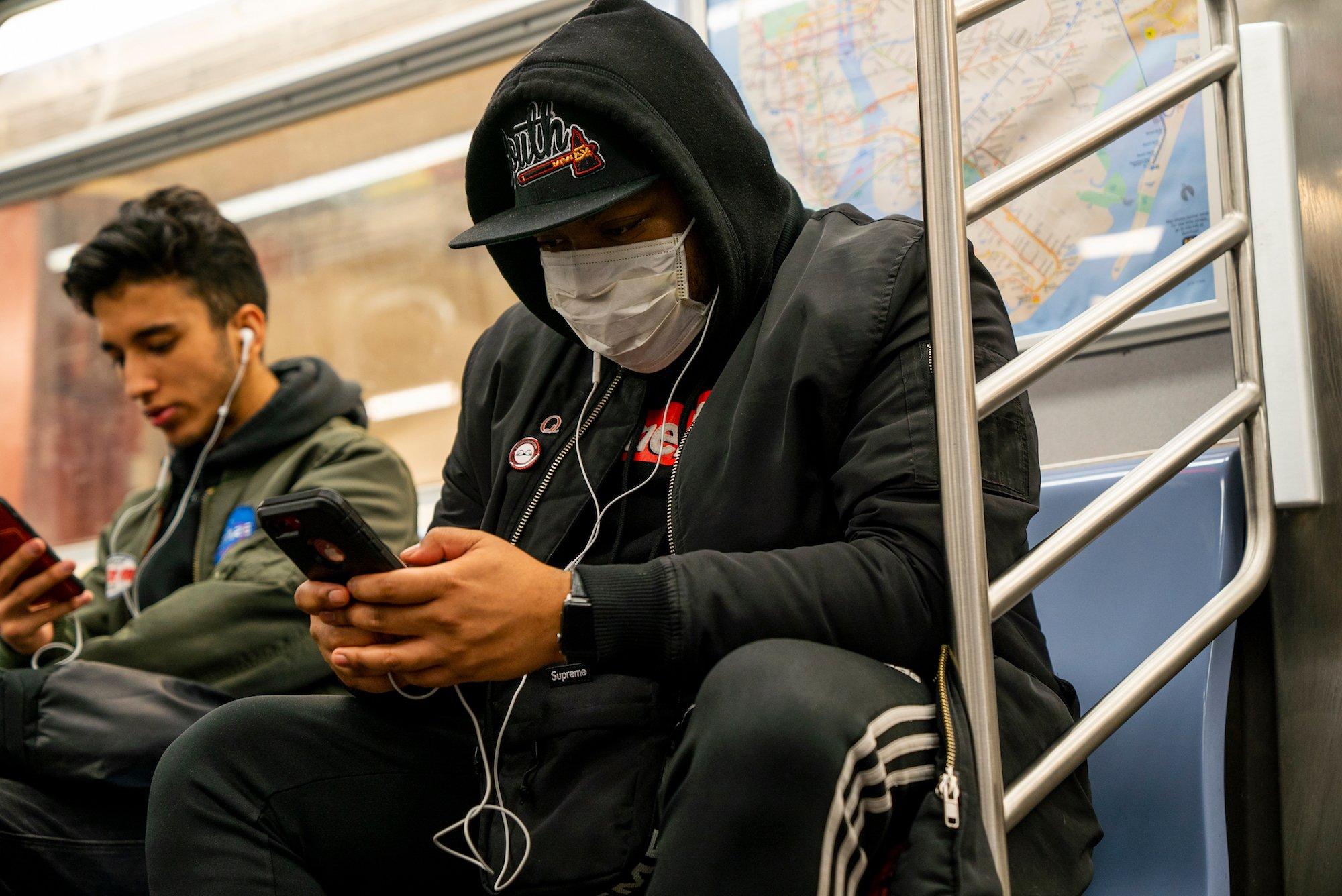 masked subway rider